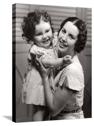 Mother and Young Daughter Hugging-George Marks-Stretched Canvas Print