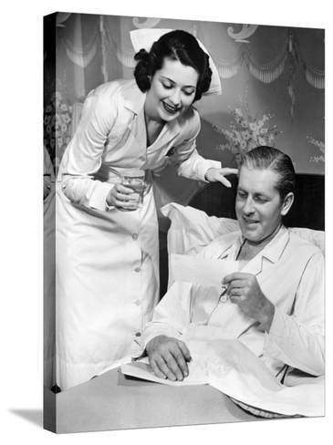 Nurse Taking Care of Sick Patient-George Marks-Stretched Canvas Print