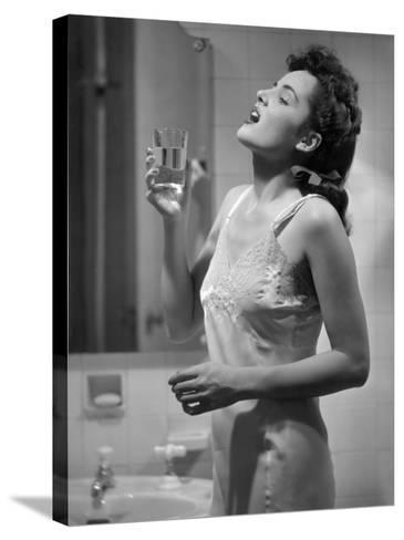 Woman Gargling Water at Bathrom Sink-George Marks-Stretched Canvas Print