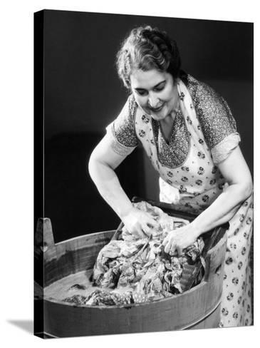 Smiling Housewife Doing Laundry-George Marks-Stretched Canvas Print