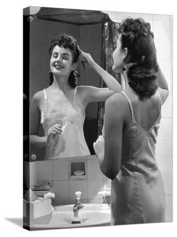 Woman Fixing Hair in Mirror-George Marks-Stretched Canvas Print