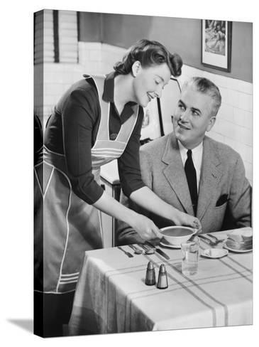 Woman Serving Soup To Husband-George Marks-Stretched Canvas Print
