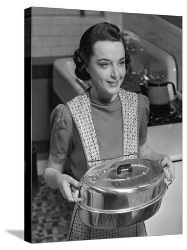 Housewife Hoding Roasting Pan-George Marks-Stretched Canvas Print