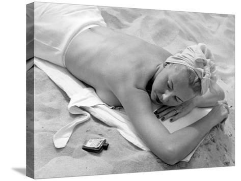 Woman Lying on Beach Topless-George Marks-Stretched Canvas Print