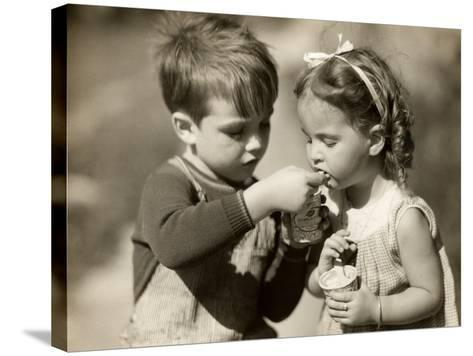 Boy Gives Ice Cream To Sister-George Marks-Stretched Canvas Print