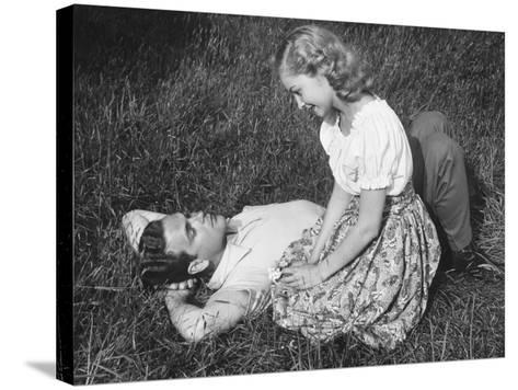 Young Couple Resting on Lawn-George Marks-Stretched Canvas Print