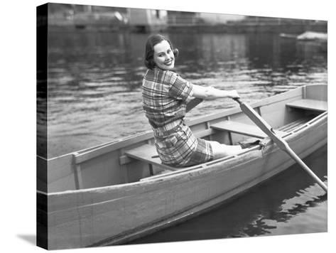 Woman Rowing Boat on Lake-George Marks-Stretched Canvas Print