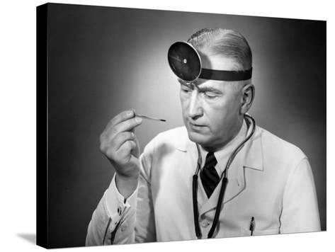Doctor Reading Thermometer-George Marks-Stretched Canvas Print