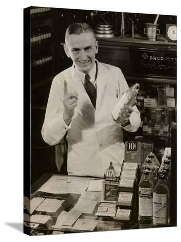 Pharmacist With Medicine-George Marks-Stretched Canvas Print