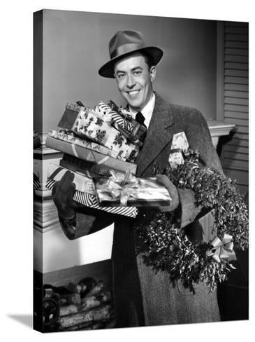 Man With Christmas Gifts-George Marks-Stretched Canvas Print