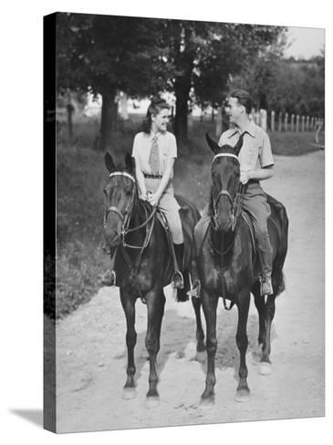 Couple Riding Horses (B&W)-George Marks-Stretched Canvas Print