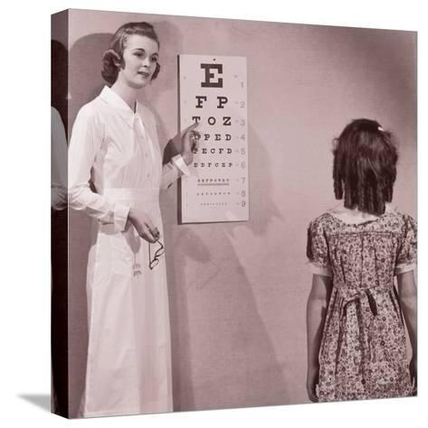 Healthcare Worker Giving Girl (8-10) Eye Examination--Stretched Canvas Print