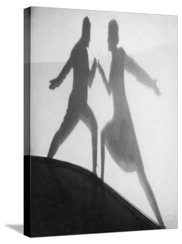 Shadow of Man and Woman Fencing--Stretched Canvas Print