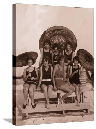 Group of Women in Bathing Suits With Parasols on Bench, 1930's--Stretched Canvas Print