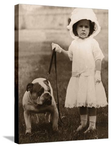 Girl in Dress and Hat, Holding Bulldog on Lead--Stretched Canvas Print