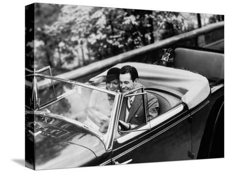 Young Couple in Vintage Soft Top Car With Golf Clubs on Back Seat--Stretched Canvas Print