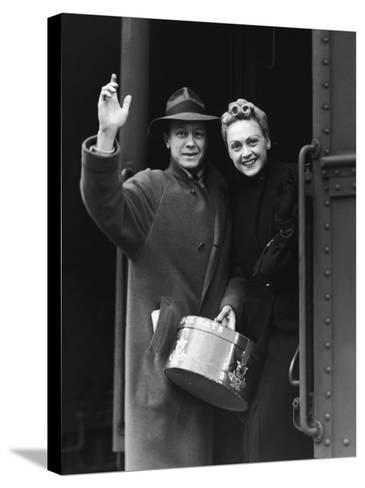 Couple Waving As They Board a Train, Circa 1930's--Stretched Canvas Print
