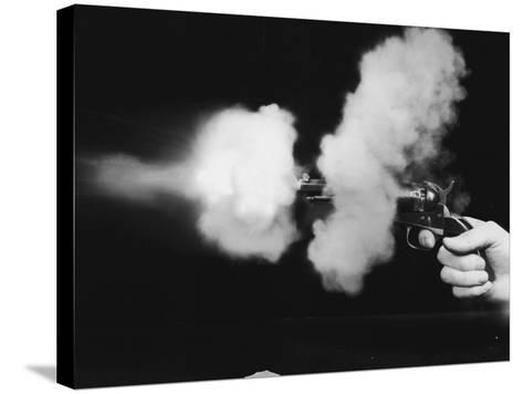 Close-Up of Gun Being Fired--Stretched Canvas Print