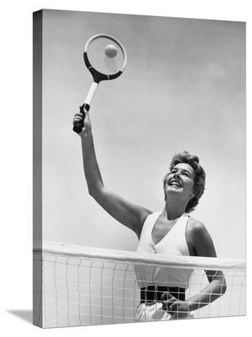 Woman Playing Tennis--Stretched Canvas Print