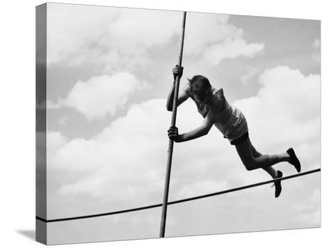 Male Pole-Vaulter Clearing Bar--Stretched Canvas Print