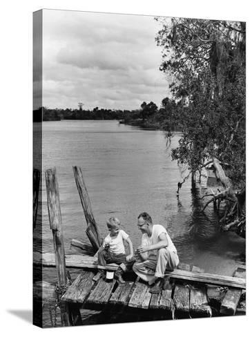 Father and Son Sitting on Dock Getting Ready To Fish--Stretched Canvas Print