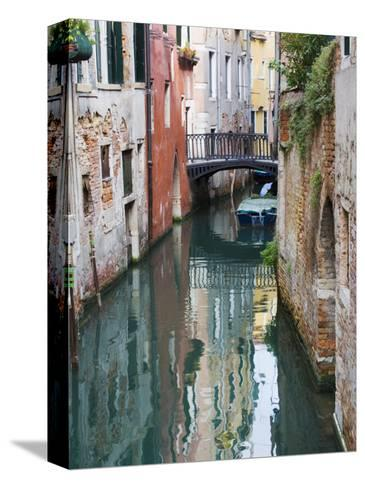 Reflections and Small Bridge of Canal of Venice, Italy-Terry Eggers-Stretched Canvas Print