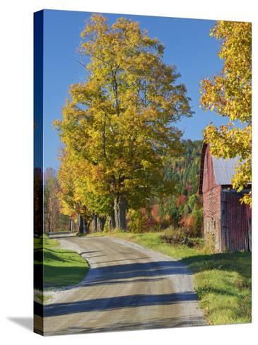 Road Beside Classic Farm in Autumn, New Hampshire, USA-Adam Jones-Stretched Canvas Print