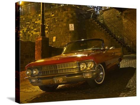 Antique Red Cadillac Parked in the Historic District, Savannah, Georgia, USA-Joanne Wells-Stretched Canvas Print