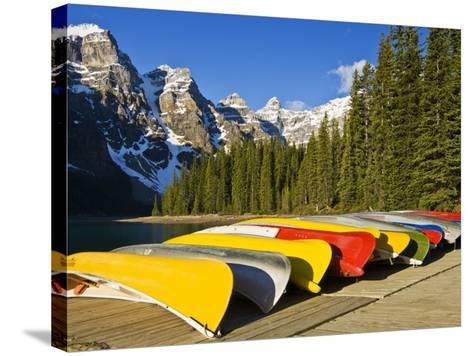 Moraine Lake and Rental Canoes Stacked, Banff National Park, Alberta, Canada-Larry Ditto-Stretched Canvas Print