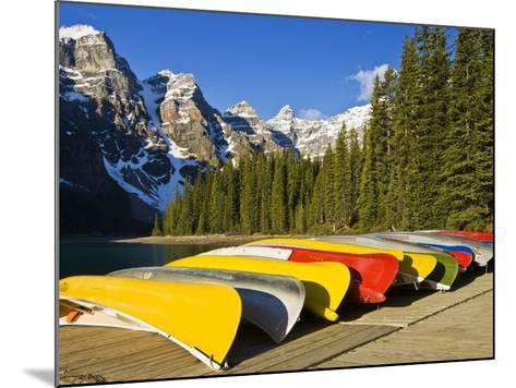 Moraine Lake and Rental Canoes Stacked, Banff National Park, Alberta, Canada-Larry Ditto-Mounted Photographic Print