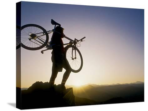 Silhouette of Mountain Biker at the Summit During Sunrise--Stretched Canvas Print