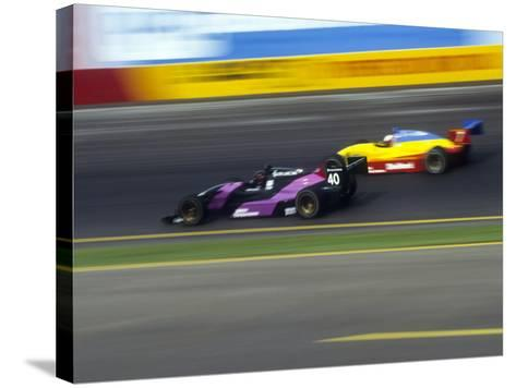 Blurred Auto Racing Action--Stretched Canvas Print