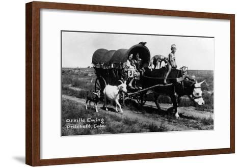 Pritchett, Colorado - Orville Ewing; Covered Wagon Scene-Lantern Press-Framed Art Print