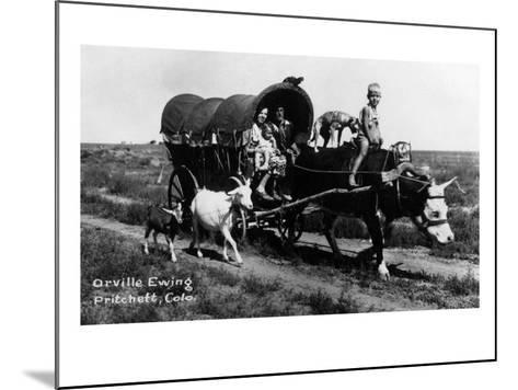 Pritchett, Colorado - Orville Ewing; Covered Wagon Scene-Lantern Press-Mounted Art Print