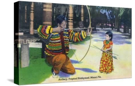 Miami, Florida - Tropical Hobbyland; Seminole Dad Showing Daughter Archery-Lantern Press-Stretched Canvas Print