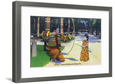 Miami, Florida - Tropical Hobbyland; Seminole Dad Showing Daughter Archery-Lantern Press-Framed Art Print
