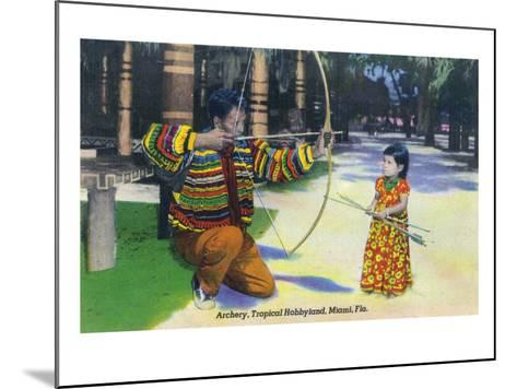 Miami, Florida - Tropical Hobbyland; Seminole Dad Showing Daughter Archery-Lantern Press-Mounted Art Print