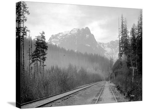 Mount Index and Great Northern Tracks at Index, 1906-Asahel Curtis-Stretched Canvas Print