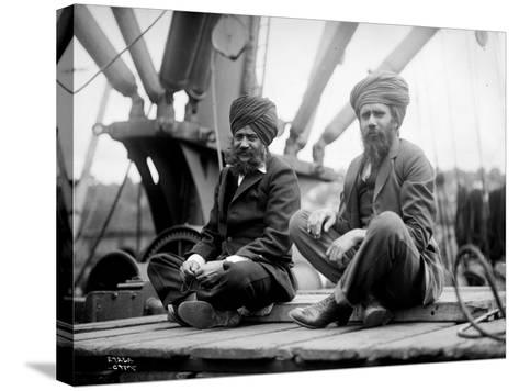 Two Sikh Men Sitting on a Dock, Circa 1913-Asahel Curtis-Stretched Canvas Print