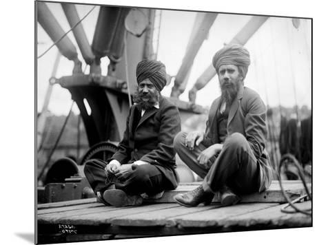 Two Sikh Men Sitting on a Dock, Circa 1913-Asahel Curtis-Mounted Giclee Print