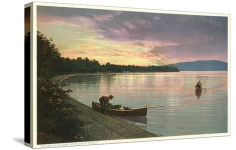 Canoing on Lake at Sunset--Stretched Canvas Print