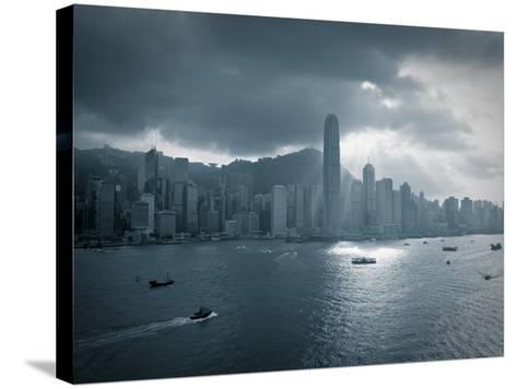 Skyline of Hong Kong Island Viewed across Victoria Harbour, Hong Kong, China-Jon Arnold-Stretched Canvas Print