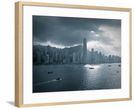 Skyline of Hong Kong Island Viewed across Victoria Harbour, Hong Kong, China-Jon Arnold-Framed Art Print