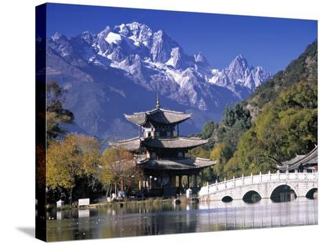 China, Yunnan Province, Lijiang, Black Dragon Pool Park and Jade Dragon Snow Mountain-Peter Adams-Stretched Canvas Print