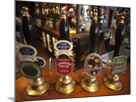 England, London, Beer Pump Handles at the Bar Inside Tradional Pub-Steve Vidler-Mounted Photographic Print
