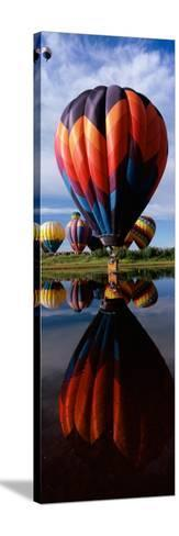 Reflection of Hot Air Balloons in a Lake, Hot Air Balloon Rodeo, Steamboat Springs, Routt County--Stretched Canvas Print