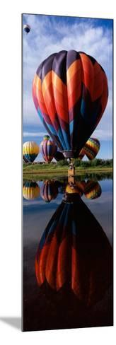 Reflection of Hot Air Balloons in a Lake, Hot Air Balloon Rodeo, Steamboat Springs, Routt County--Mounted Photographic Print