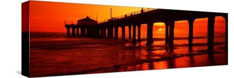 Silhouette of a Pier at Sunset, Manhattan Beach Pier, Manhattan Beach, Los Angeles County, CA--Stretched Canvas Print