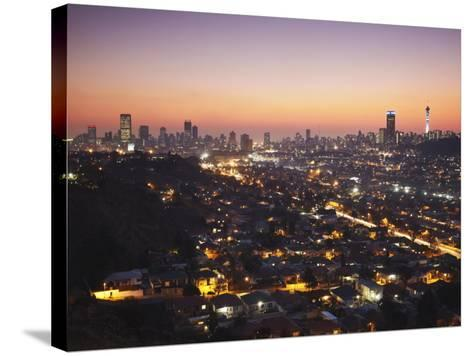 View of Johannesburg Skyline at Sunset, Gauteng, South Africa-Ian Trower-Stretched Canvas Print