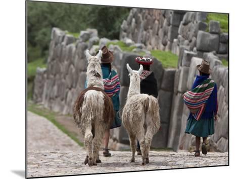 Peru, Native Indian Women Lead their Llamas Past the Ruins of Saqsaywaman-Nigel Pavitt-Mounted Photographic Print